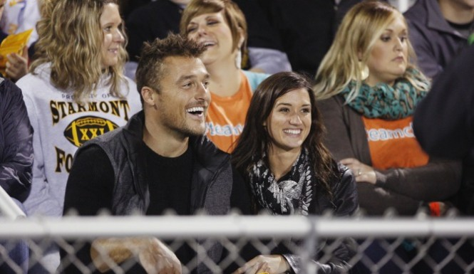 Chris and Jade watch a football game because that's the only thing to do in Iowa.
