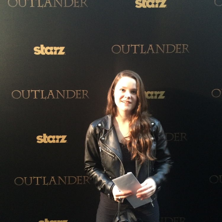 This is the face of someone who does not know why she is at the Outlander premiere.